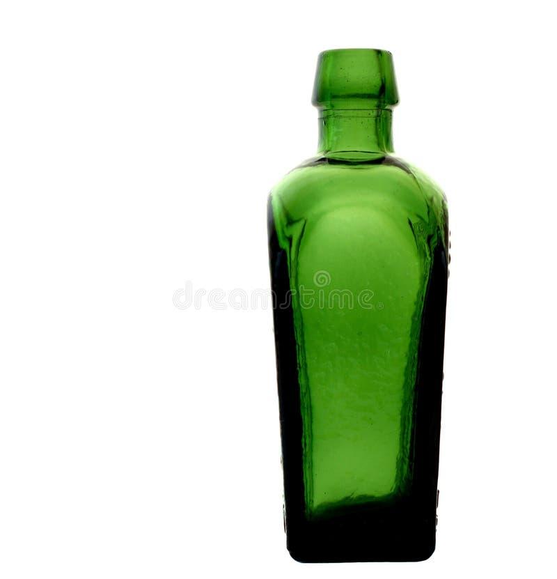 Garrafa de vidro verde retro imagens de stock royalty free