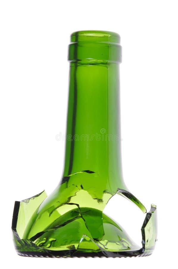 Garrafa de vinho verde quebrada fotografia de stock