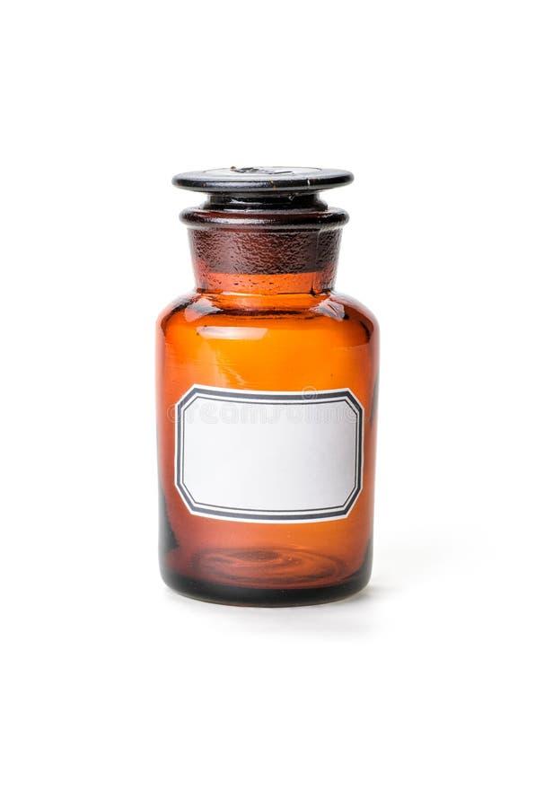 Garrafa do Apothecary feita do vidro marrom com etiqueta foto de stock
