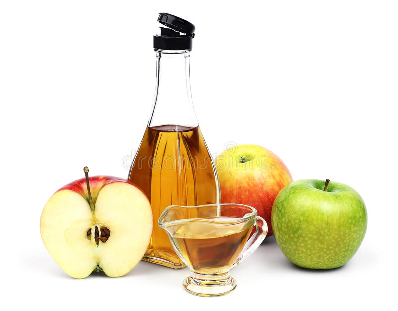 Garrafa do vinagre e das maçãs de sidra de maçã imagem de stock