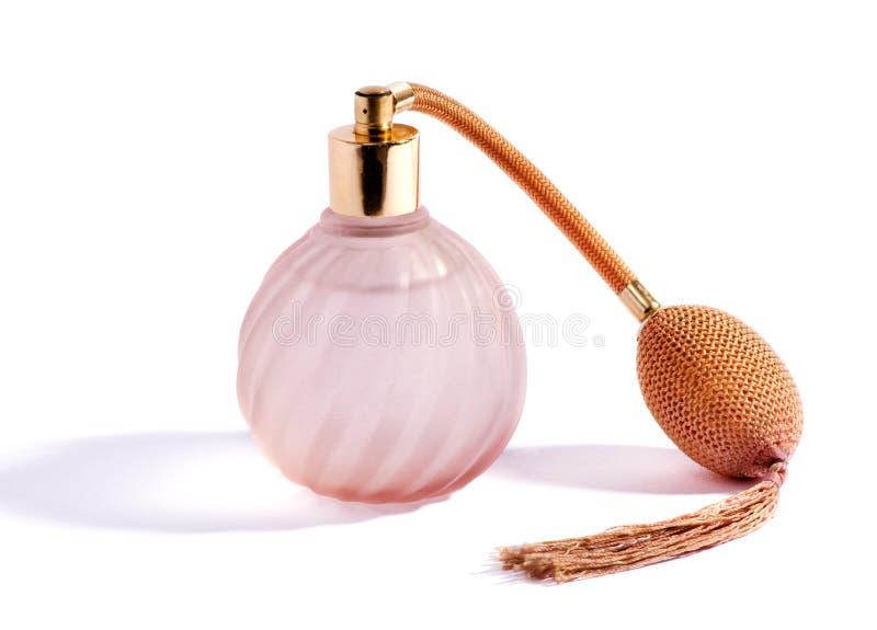 Garrafa e atomizador cor-de-rosa de roda de perfume fotografia de stock