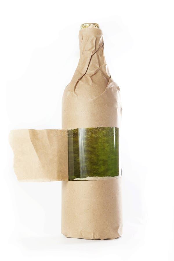 Garrafa envolvida no saco de papel foto de stock royalty free