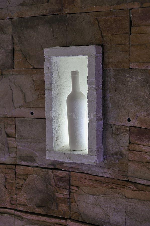 garrafa na parede imagem de stock