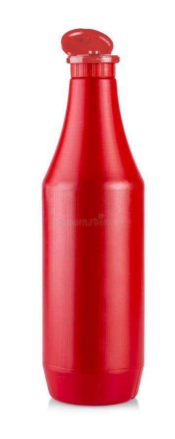 A garrafa plástica aberta do molho da ketchup isolada no fundo branco foto de stock