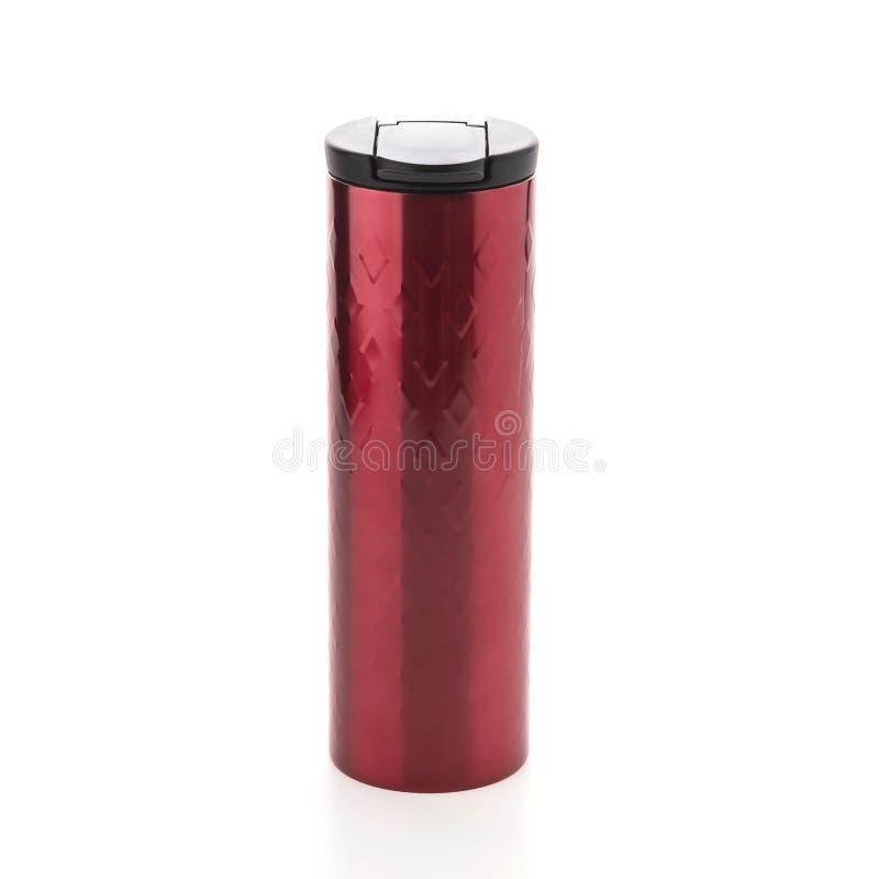 Garrafa térmica vermelha da secadora de roupa do café foto de stock
