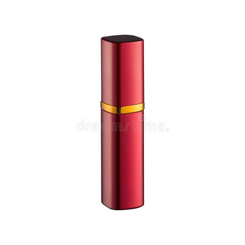 Garrafa vermelha com um pulverizador para o perfume, coberto com uma tampa, em um fundo branco fotografia de stock royalty free