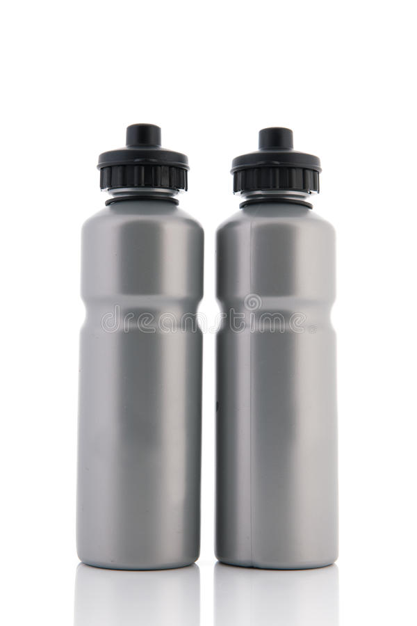 Garrafas de água cinzentas do esporte foto de stock