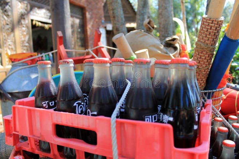 Garrafas estrangeiras de Coca-Cola na caixa fotografia de stock