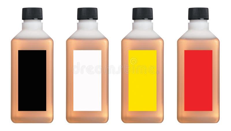 Garrafas plásticas com líquido colorido para dentro imagem de stock royalty free