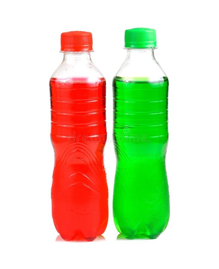 Garrafas plásticas dos refrescos no fundo branco imagens de stock