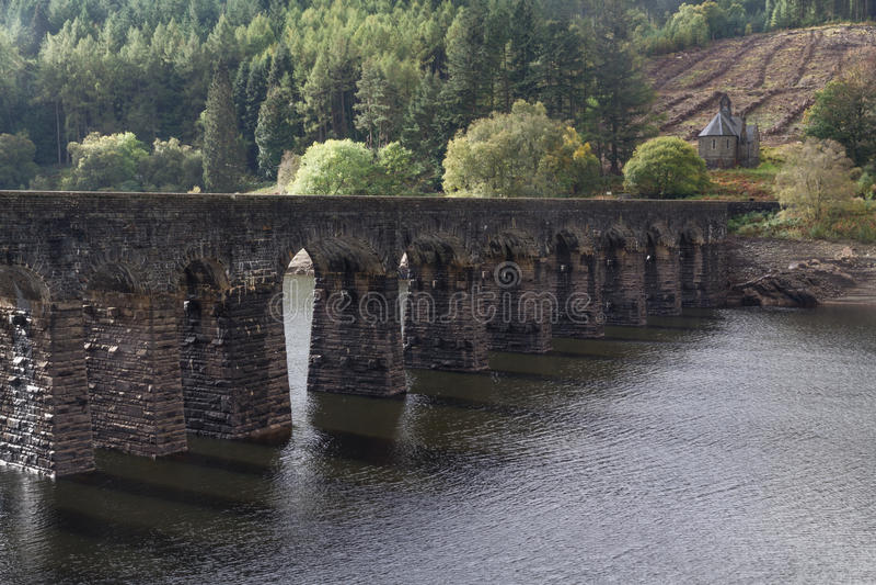 Garreg-ddu submerged dam with road on top. Arches of Submerged Dam, with road on top. Garreg-ddu Reservoir, Elan Valley, Powys, Wales, United Kingdom, Europe stock image