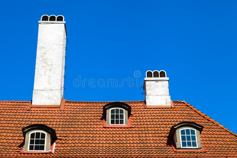 Garret roof, Riga, Latvia. Garret roof with window and chimney, Riga, Latvia stock photography