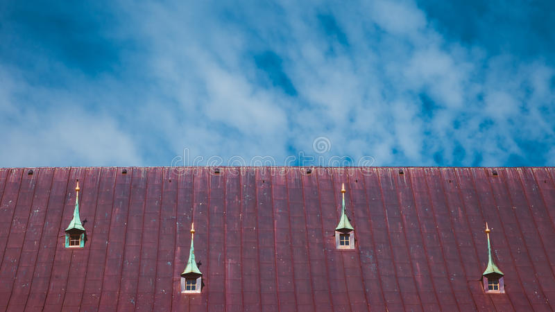 Garret roof with window and chimney, Riga, Latvia. Red garret roof with window and chimney, Riga, Latvia royalty free stock photo
