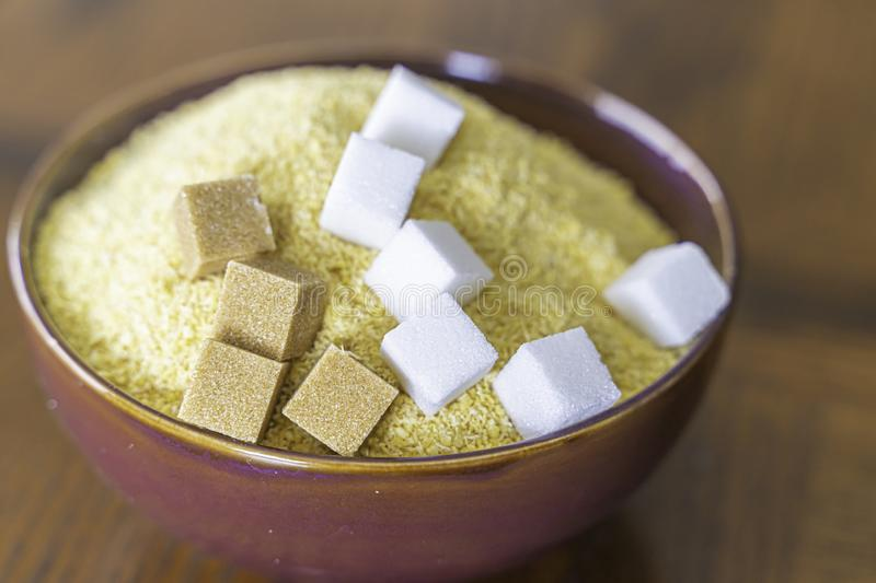 Garri with brown and white Sugar cubes a popular Nigerian Snack. Garri and Sugar a popular Nigerian Snack - Drink Garri stock photography