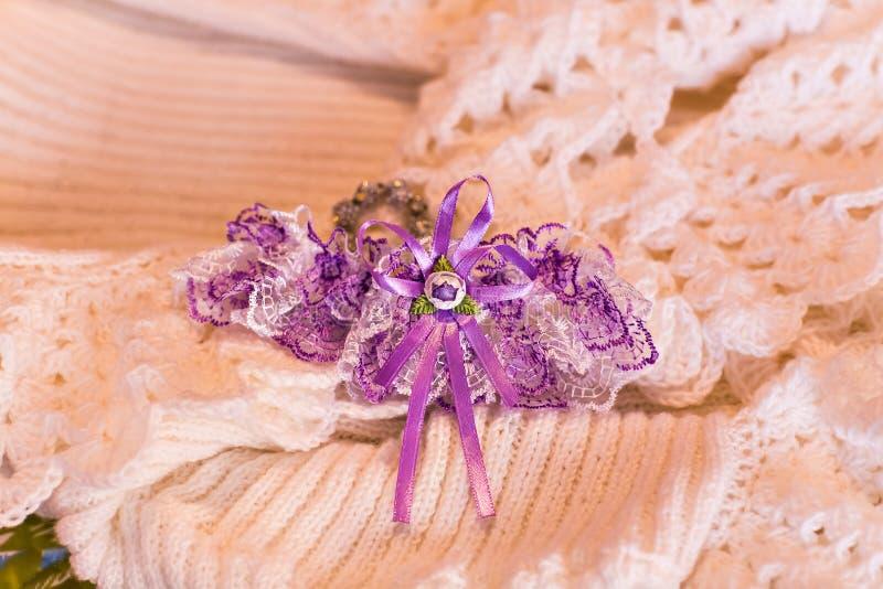 Garter. Beautiful wedding bridal garter. Wedding day moments stock photography