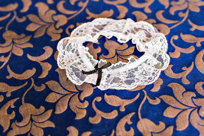 Garter. Beautiful wedding bridal garter. Wedding day moments stock images