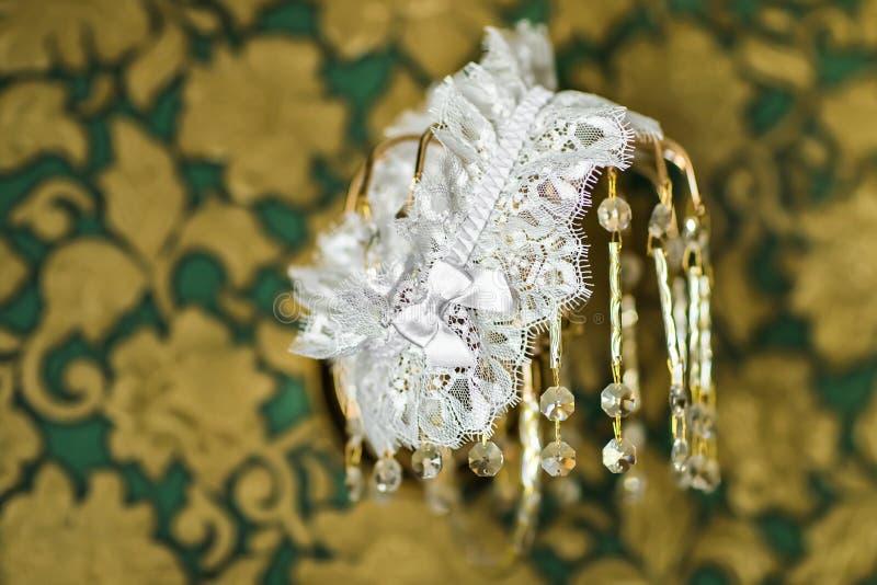Garter. Beautiful wedding bridal garter. Wedding day moments royalty free stock image