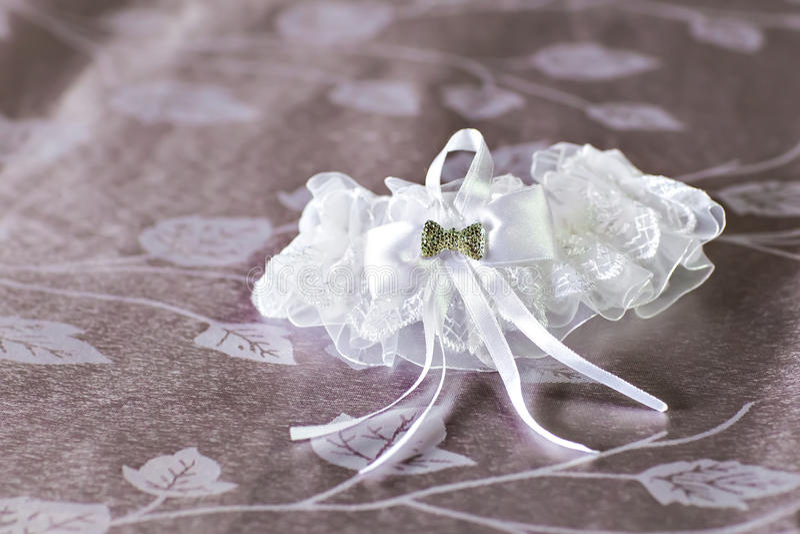 Garter. Beautiful wedding bridal garter. Wedding day moments stock image