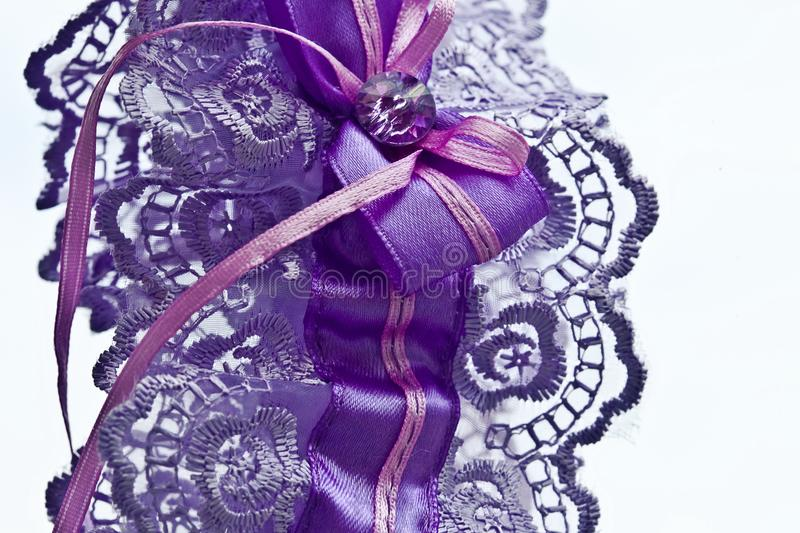 Garter of a bride on a white background, close-up royalty free stock images