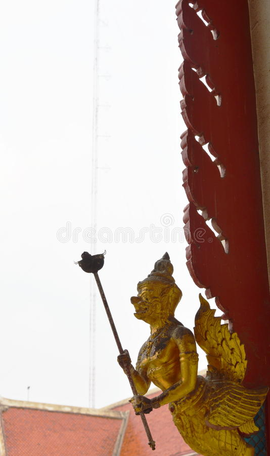 Garuda hold torch in Buddhist temple stock images