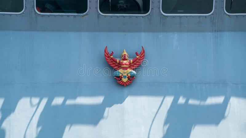 Garuda or Thai mythical bird emblem on board Royal Thai navy ship stock image