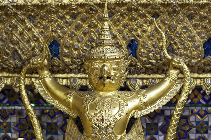Garuda on the wall in Wat Phra Kaew or name officially as Wat Phra Si Rattana Satsadaram.  stock photography