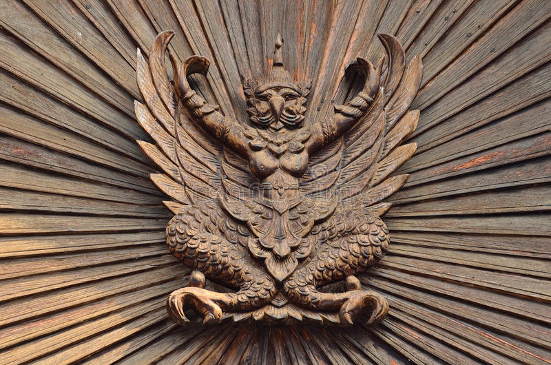 Download Garuda on the wooden wall stock photo. Image of object - 43278266