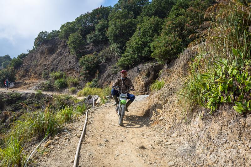 Garut, Indonesia - August 12, 2018 : A local are riding motorcycle on Papandayan Mountain. Papandayan Mountain is one of the royalty free stock photography