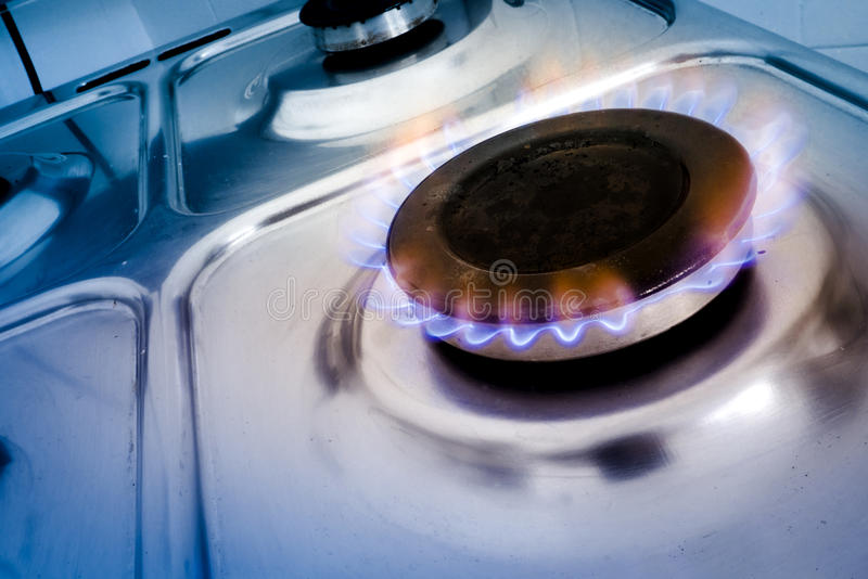 Gas burner on stove blue ligth stock image