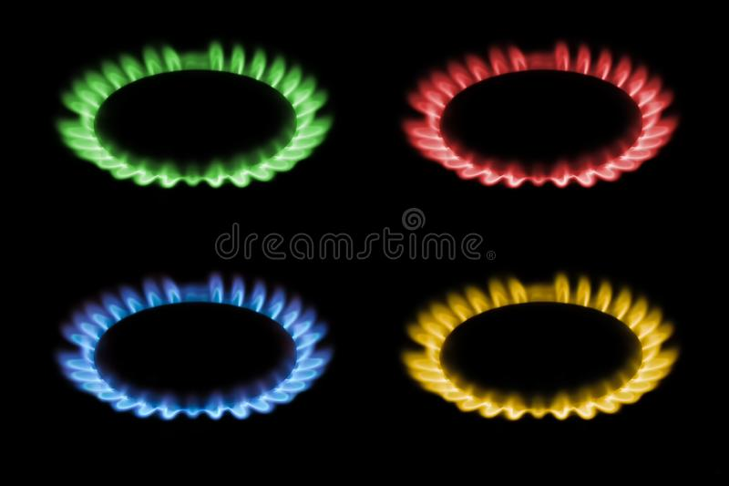 Gas burns with red, blue, yellow, green flame on a black background, a collage and three different-colored burning gas. royalty free stock images