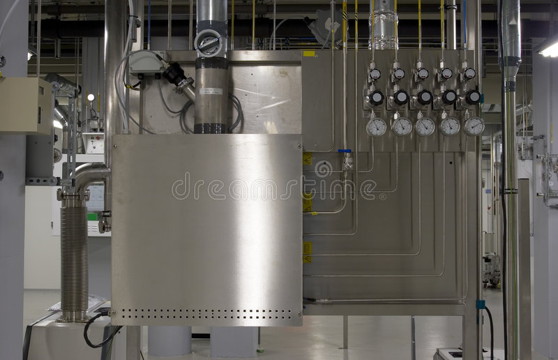 Gas cabinet and manifold. A gas cabinet and manifold used in PE CVD processes stock images