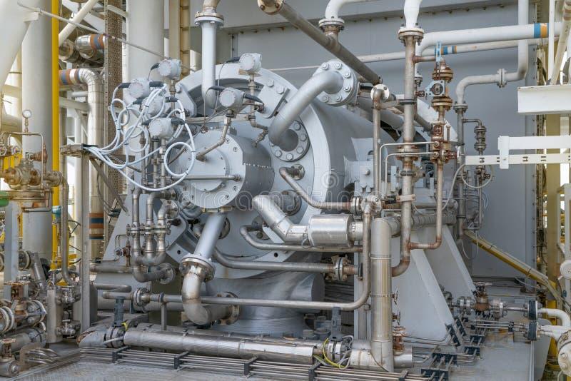 Gas compressor bundle on offshore oil and gas central processing platform. Gas compressor bundle on offshore oil and gas industry with piping and instrument stock photos