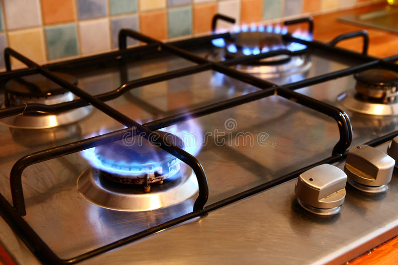 Gas cooker. Cooker gas hob with flames burning stock image