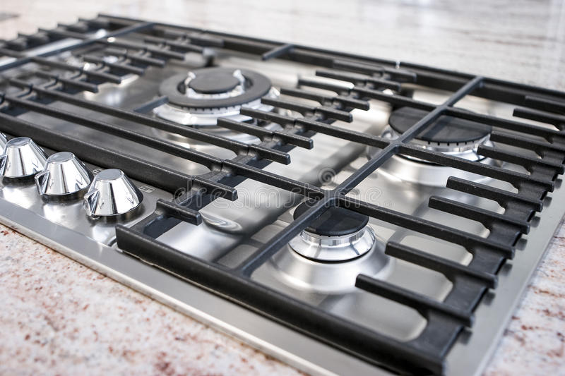 Gas cooktop panel. Modern gas kitchen with traditional cooktop panel stock image
