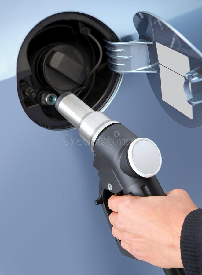 Gas en el coche fotografía de archivo