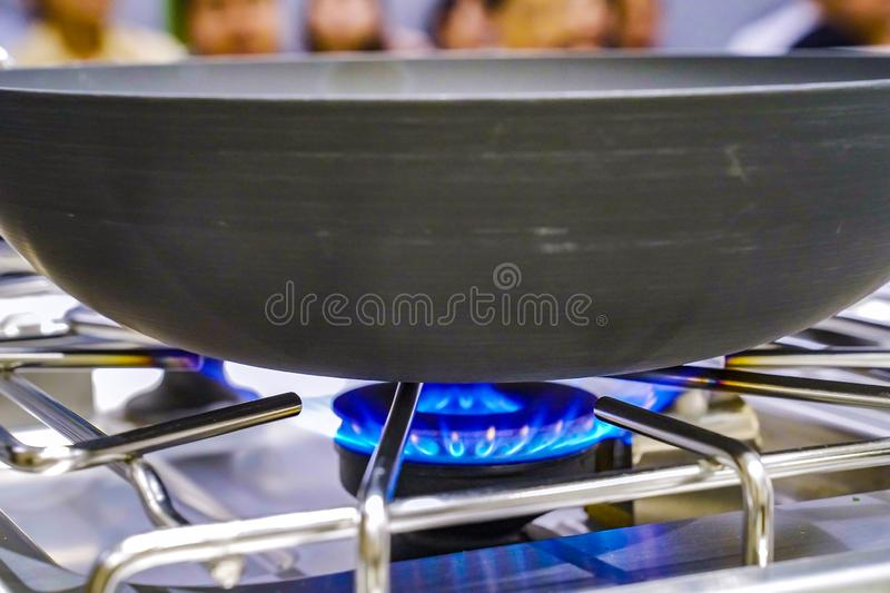 The Gas fire from the stove with the pan on it, in the training - study cooking classroom. The Gas fire from the stove with the pan on it, in the training stock photos
