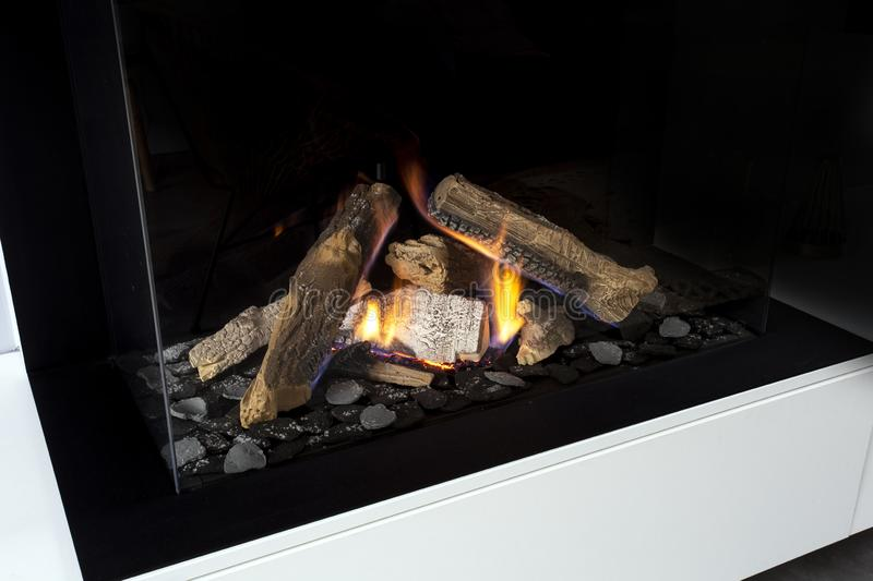 Gas fireplace with white mantel modern interior luxury design, close-up in a modern home royalty free stock images