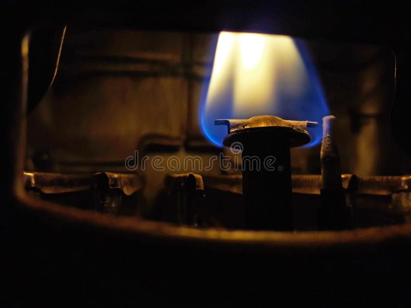 Gas flame of a water heater royalty free stock images