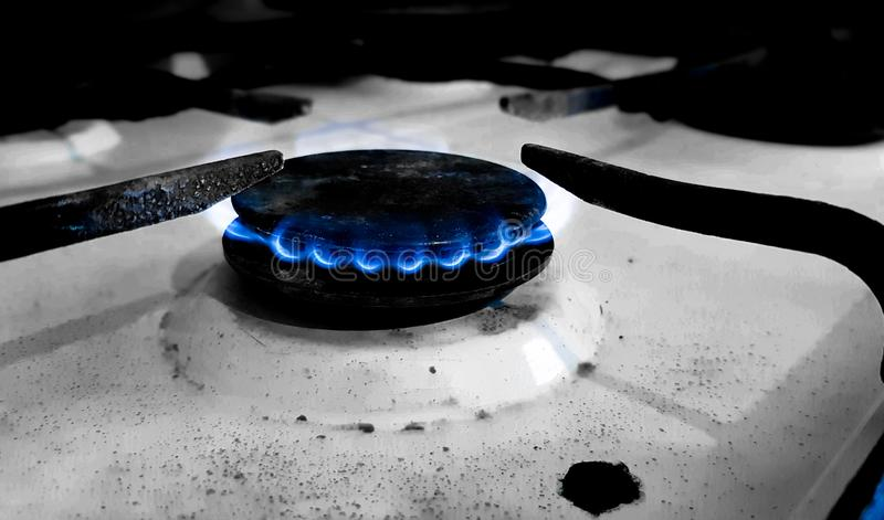 The gas flames of an old and dirty stove royalty free stock photo