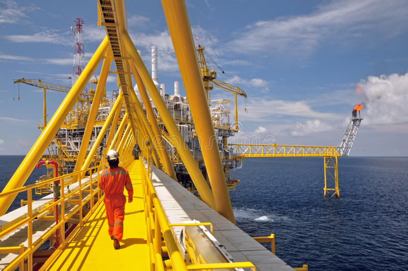 The gas flare is on the oil rig platform stock photography