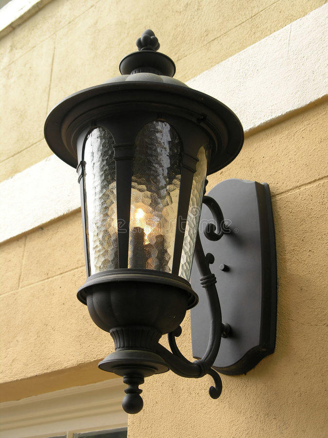 Gas Lamp fixture - yellow wall stock images