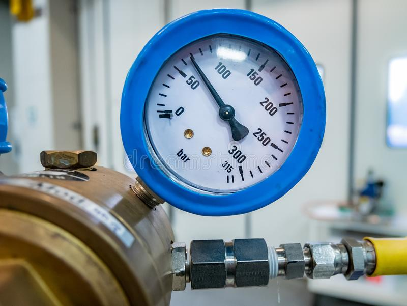 Gas manometer on a valve royalty free stock photography