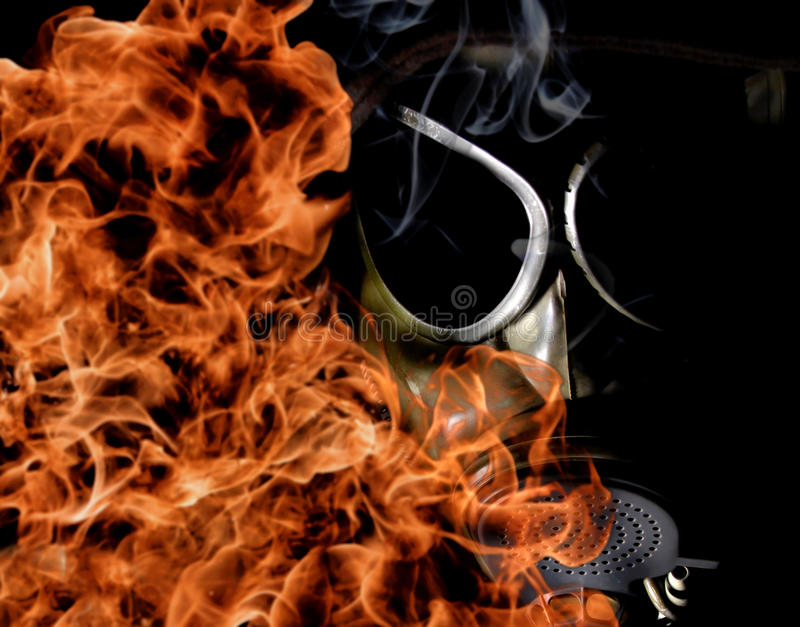 Gas mask. With fire in a dark stock images