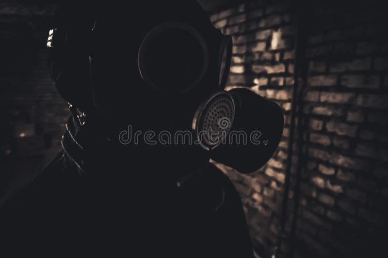 Gas mask in basement. royalty free stock image