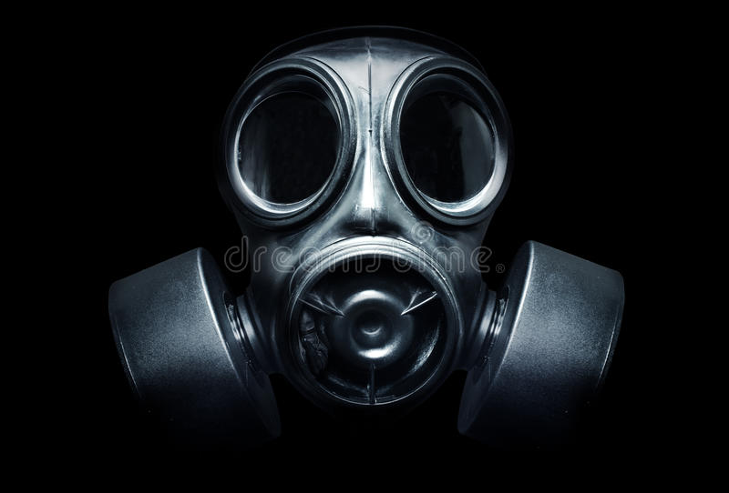 Gas Mask. A black military gas mask for protection stock photos