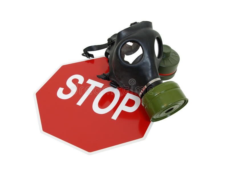 Gas mask and stop sign. Rubber gas mask to protect the wearer from airborne pollutants and toxic gases and stop sign - path included stock photography