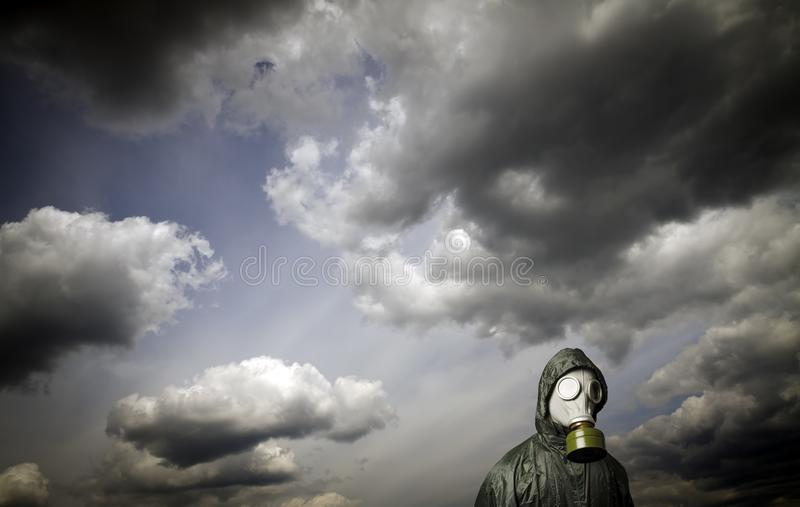 Gas mask. Survival theme. Gas mask and dramatic sky. Survival concept royalty free stock photography