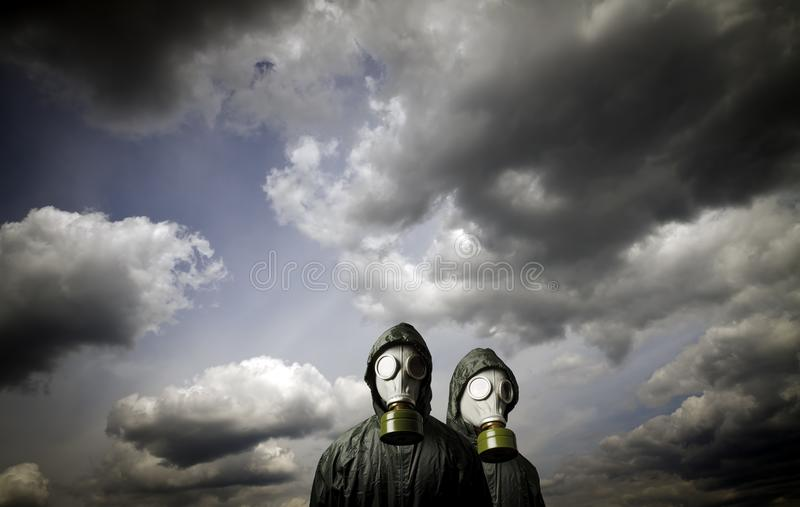 Two gas masks. Survival theme. Gas masks and dramatic sky. Survival concept royalty free stock photo