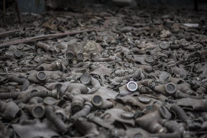 Gas masks. Many dusty gas masks trashed on the ground stock photos