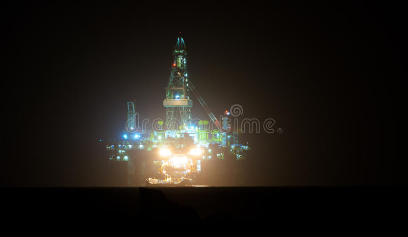 Gas Oil platform at night. Israel gas and oil rig in Cyprus. Offshore exploration platform royalty free stock image